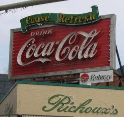 This is what the historic Coca-Cola sign looked like when the building was owned by respectable people, like Pete and Joy Richoux.