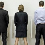 Woman-standing-urinal-with-men